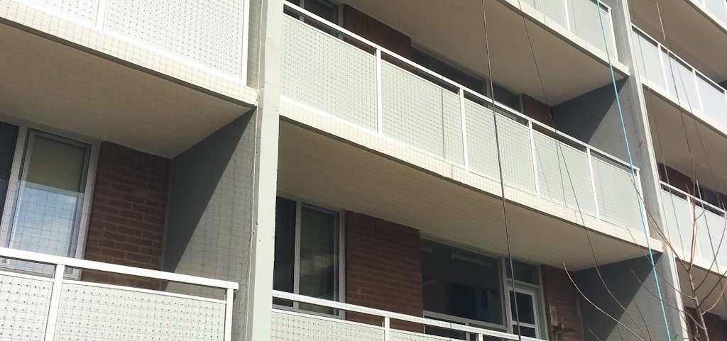 Balcony Netting on entire apartment building - exterior view.